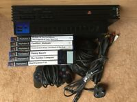 PlayStation 2 with 6 games & 2 controllers