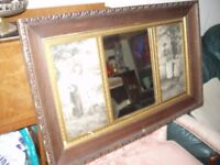 a decorative oak .overmantel/mirror circa 1930s with pictures either side mirror