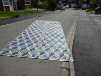Woven brightly coloured plastic awning matting