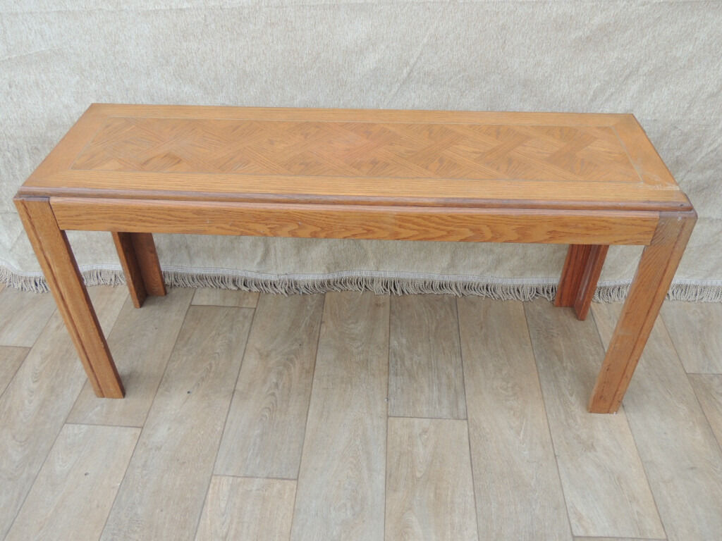 Console Table (Deliveryin Eltham, LondonGumtree - Console table (Size 132cm W; 41cm D; 64cm H); Unique retro design console table; Suitable for hallway use due to the compact size; Strong and good overall condition; Golden inlayed trim inside the top; Few minor marks and 1 of the legs has...