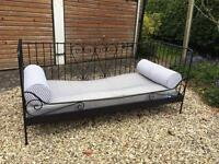 Day bed with mattress and cushions