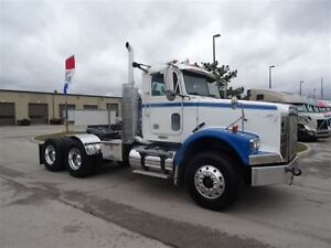 2010 Freightliner FLD12064SD Heavy Spec Day Cab