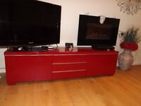 Red tv stand with two large drawers and three small storage shelves