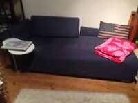 Ikea blue single sofa-bed with set of spare covers