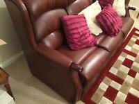 Three seater sette and recliner chair in red leather
