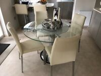 Quatropi round glass dining table and chairs