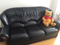 Three seater black leather sofa-very good condition