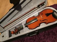 A gorgeous violin with the original bow and box.