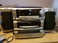 Old school hi fi system with turntable, 3 disc CD changer, radio and tape