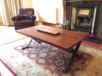 Lovely wooden coffee table with cast iron legs and detailing