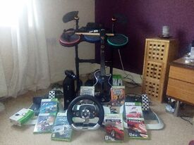 Xbox 360 and racing wheel plus a lot more !