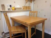 Folding extending dining table