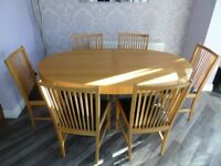 Oak Extending Dining Table, six chairs and matching cabinet