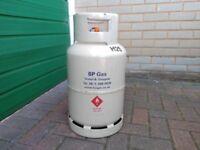 Camping gas bottle half full and regulator