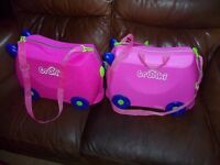 2 trunkie suitcases in pink sit on a ride cases cheap