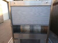 Commercial display fridge with shutter