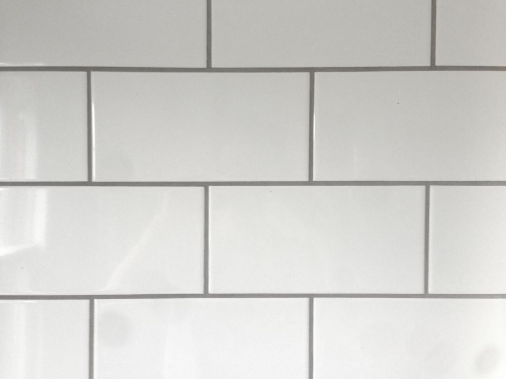 White ceramic brick shaped metro tiles with grey grout adhesive in walthamstow london - White brick tiles black grout ...