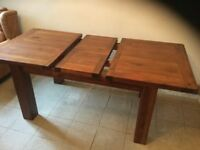 Bargain wooden dining table with four matching chairs
