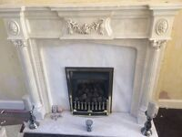 Fireplace surround including fire