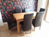 Solid Oak Dining Table and Six Leather Chairs