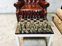 Handmade chess set and table.