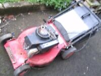 CHAMPION PETROL LAWNMOWER,NEEDS SOME ATTENTION.