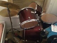 5 Piece Drum Kit, Rockburn, Selling due to space limits, has minor rust on symbols and cracked paint