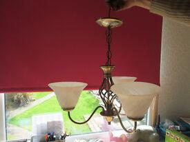 Three arm ceiling light.