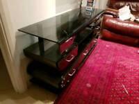 Tv table like new black 5 draws