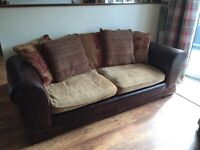 Beautiful 3 seater sofa and 1 armchair. Leather and material mix.