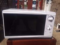 Nearly new microwave in vgc
