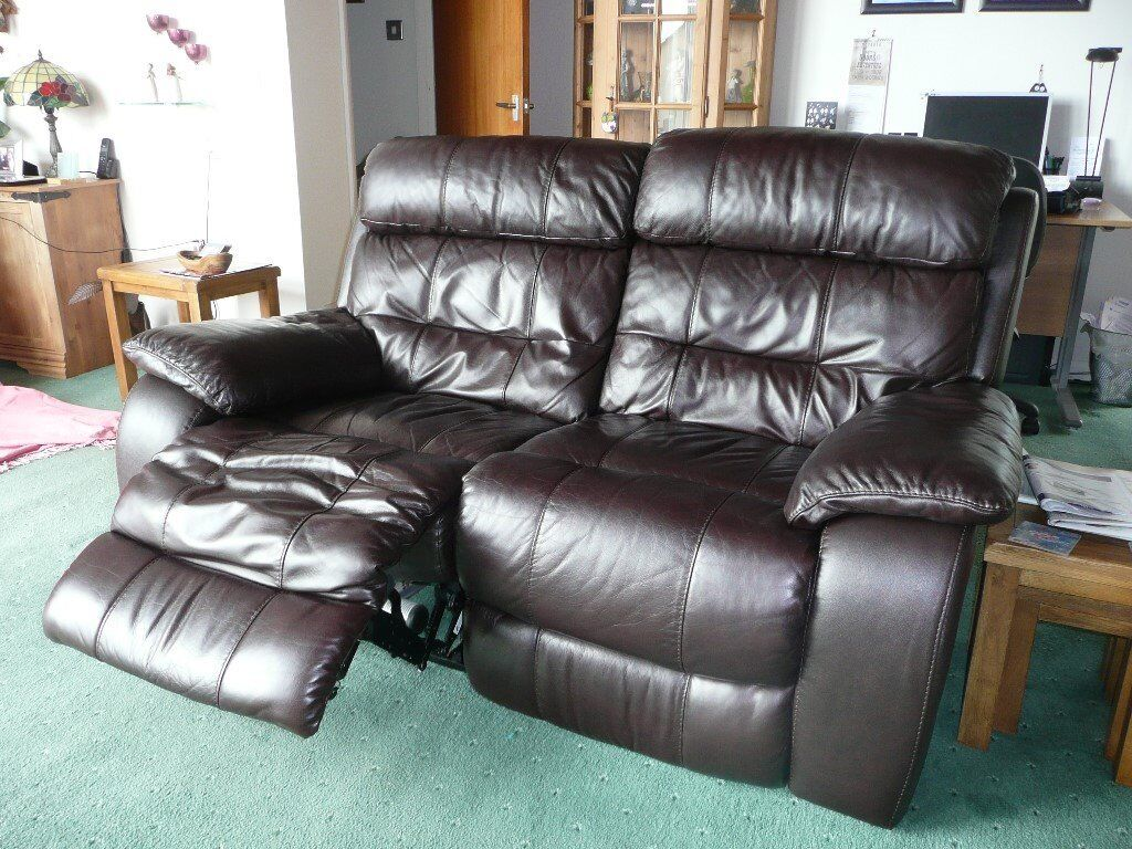 Brown leather electronic reclining sofa. Good condition. 2 years warrentee remaining