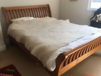 Very strong solid wood king size bed frame,5ft in very good condition for £200, mattress additional