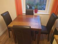 Solid wooden dining table with 4 faux leather chairs
