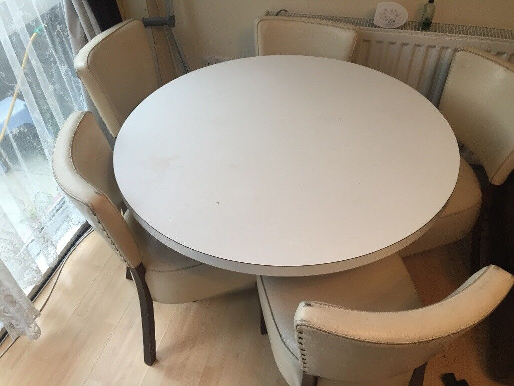 Vintage Dining Table comes with 5 quality leather chairs