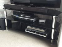 TV Stand. Large Dark Glass TV stand with two additional shelves for DVD players etc.