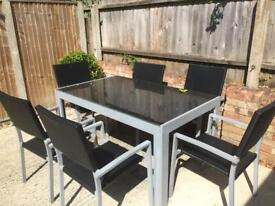 Glass metal table and 6 chairs