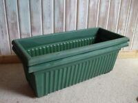 Long green plastic pots