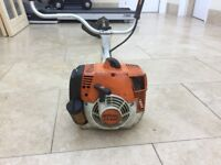 Stihl FS400 professional strimmer complete with bump head and lin