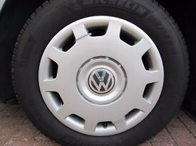 Four genuine Volkswagen used plastic wheel trims - Fit wheel size 195 / 65 R15.