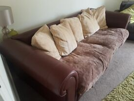 Brown and cream sofa