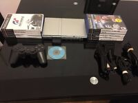 sony playstation 2 slim in silver, rare wireless controller( no leads), and 9 games..