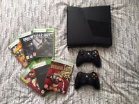 Xbox 360, 2 controllers and 6 games.