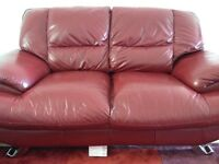 3&2 seater sofas red leather with silver feet purchased from Reid's