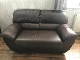 Brown leather sofas and arm chair