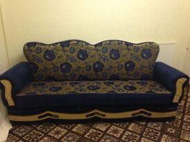 Blue coloured settee