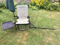 Korum accessory chair with extending rod rest , bait tray and brolly holder.