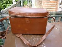 Vintage old collectible Rowi camera bag and Kodak 8mm Movie Camera,