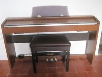Casio PX 730 Electric Piano including adjustable piano stool with lid.