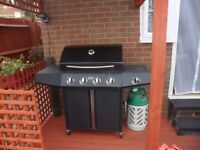 Montana 4- burner gas barbeque with gas bottle